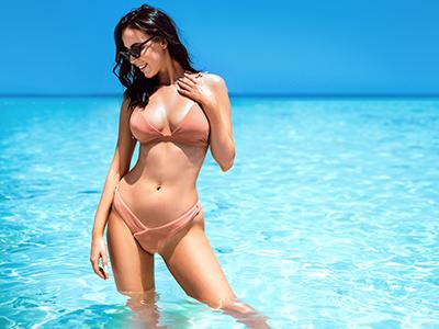 Portrait of a sensual young woman enjoying warm, tropical ocean water