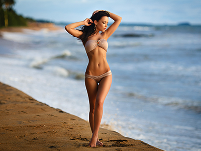 Beautiful young girl in a sexy bikini on the beach